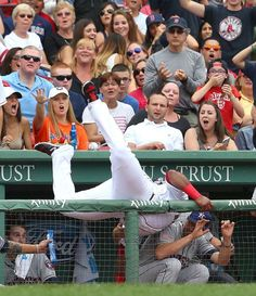 Dugout down -  Pablo Sandoval of the Boston Red Sox falls in the Houston Astros dugout as he catches a ball hit by Preston Tucker of the Houston Astros on July 4 in Boston. The Red Sox won 6-1. -  © Jim Rogash/Getty Images