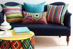Simple vintage sofa with boho pillows