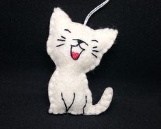 A happy cat hanging ornaments is made with wool felt. I have some of these ready, but you can order it in any other color, please write me a mail about your custom order, or choose at the right side. Measurements: this cat is about 6 cm (2.36 inches) tall. You can ask for