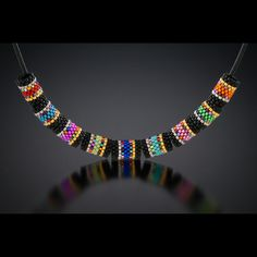 Inspiration Necklace by Mary Cody. Simple peyote cylindrical beaded beads done with delicas. Beaded Beads, Beads And Wire, Beaded Earrings, Beaded Bracelets, Making Bracelets, Necklaces, Stretch Bracelets, Bead Jewellery, Seed Bead Jewelry