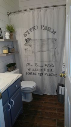 """My version of The Cozy Old """"Farmhouse"""": Painter's Dropcloth Becomes DIY Grain Sack Shower Curtain. I made this shower curtain from a canvas drop cloth. DIY Farmhouse shower curtain, Shiplap, #DIYShiplap #FarmhouseShowerCurtain, #DIYShowerCurtain"""