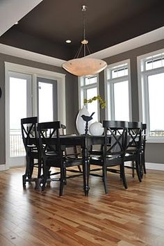 Love all the windows, the paint color, the table, and the light!  Great dining room.