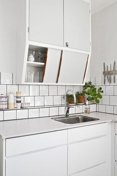 white + clean. would add slashes of color with smeg appliances.