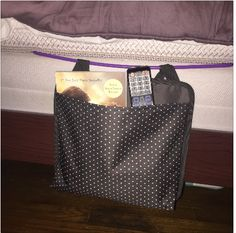 Snap the Oh-Snap Pocket onto a hanger and then slide it between the box spring and mattress for instant bed side storage!