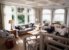 Family room. Love the light and the ceiling detail. The nautical colors of navy, white, and tan with accenting wood tones is timeless and rich,