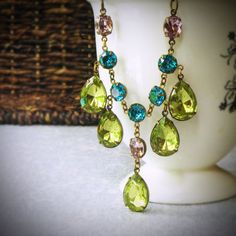 This stunning, custom crafted teal green and lemon yellow vintage rhinestone statement necklace is simply dripping in elegance. Perfect for the bride