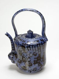 "Master ceramist Norm Schulman: attended Parsons School of Design and earned a BS degree from New York University where he took his first ceramic class with Ruth Canfield (AU 1919). Norm Shulman, Mottled Blue Teapot, 1990  salt glazed porcelain  h: 10"" w: 7"" d: 5-3/8""  courtesy of the artist"