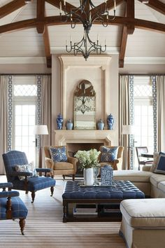 Beautiful windows and drapes. Nice to follow through with lots of use of the blue color; keeps a neutral room from being boring.