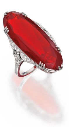 *PLATINUM, FIRE OPAL AND DIAMOND RING The oval-shaped fire opal measuring approximately 33.8 by 12.9 by 8.1 mm, accented by single-cut diamonds weighing approximately .40 carat,