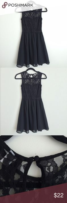 Divided by H&M fit and flare black dress Divided by H & M lace top fit and flare dress  Condition: preowned, no holes or stains, normal wear from washing and wearing   Color: black  Measurements: Size 4 Underarm to underarm is approximately 15 inches across.  Length from back of neck to bottom of hem is approximately  32 1/2 inches.  Features: black lace top, gathered elastic waist, flared skirt, lined Divided Dresses