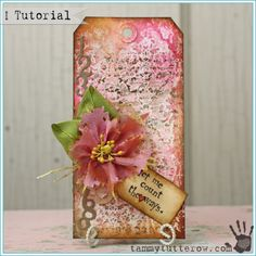 Count the Ways Art Tag Tutorial - stamped distress paint background hang tag with beautiful layers and die cut flower.  Found on tammytutterow.com