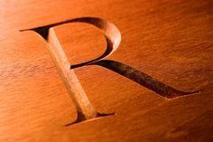 i adore the beauty of this wood carved letter carved