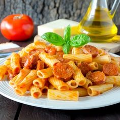 Rigatoni w/Portuguese Sausage A simple local-style pasta with Portuguese sausage and a creamy tomato sauce.  You can have a nice dinner in 30 minutes!