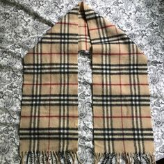 Burberry London Scarf Lambswool This scarf is more for a kid - although could be worn by an adult as well - it measure 46 inches without the fringe on both ends .. 100% authentic Burberry Accessories Scarves & Wraps