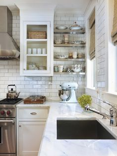 gorgeous kitchen... and a way to hide a stack with shelves and backsplash.