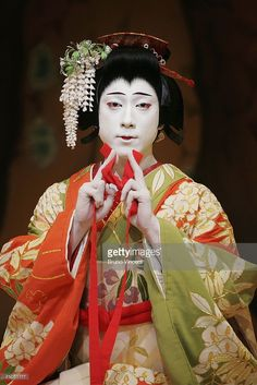 Japanese actor Ebizo Ichikawa XI performs as Spirit of the Wisteria in Fuji Musume as part of Kabuki at Sadlers Wells May 30, 2006 in London, Enlgnad. Ebizo Ichikawa XI, heir apparent of a Kabuki dynasty stretching back thirteen generations, will perform two classic Kabuki productions with a troupe of thirty musicians and actors on the London stage.