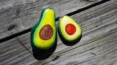 Simple, hand painted avocados on Montana river rocks.