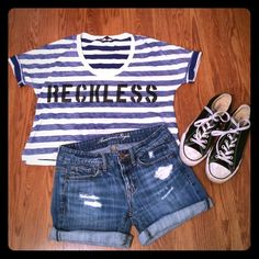 "Crop Top from Urban Outfitters Super cute crop top from Truly Madly Deeply from Urban Outfitters. Says ""RECKLESS"" on blue and white horizontal stripes. The sleeves can be rolled up if desired for a really cute look. Has a great scoop neckline. In great condition, super comfy and cute. Shoulder to front hem is 19 inches. Shoulder to back hem is 21 inches. Bust is 20 inches measured flat. Urban Outfitters Tops Crop Tops"