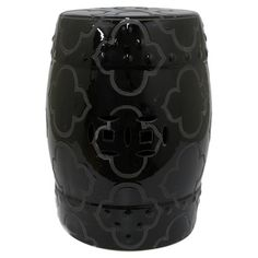 Offer guests an extra seat or rest a tray of cocktails atop this lovely garden stool, showcasing a quatrefoil motif in black with cutout accents.