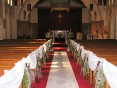 white full pew aisle marker ends calgary wedding ceremony flowers
