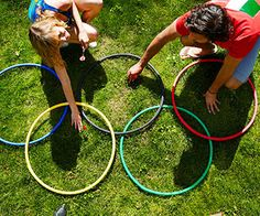 Darchery-It's darts meets archery! First, cover hula-hoops in colored crepe paper to mimic the rings. Then, on the grass, overlap five hula-hoops into the formation of the Olympic rings. Each player gets four darts, which they launch at the rings -- each worth a different point value -- from 15 feet away.