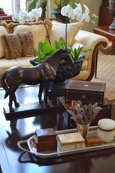 Coffee table vignette, including silver tray, from The Polo House