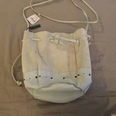 Bottega Veneta Mint Pouch crossbody This is an adorable suede and leather mint pouch. It's new with tags but I completely forgot I had this and didn't properly store it, has pink color transfer as shown in 1st pic. Was purchased from Neimans. Has long straps and you can wear this crossbody style or shorter if preferred. Fits an iPhone 6/6s and more. Bottega Veneta Bags