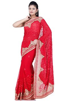 This red drape is adorned with golden & red thread motifs that add beauty & bling to the product. This is further beautified with sleek floral border that is adorned with golden butties. This is paired with a classy blouse that carries similar look.