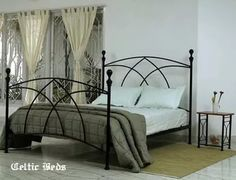 Gothic bedroom Black Wrought Iron Gothic Metal Bed With White Toss Pillows And - Home decor Wrought Iron Beds, Wrought Iron Fences, Adult Bunk Beds, Iron Headboard, Victorian Bedroom, Gothic Metal, Toss Pillows, Decor Pillows, Metal Beds