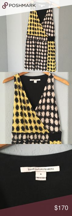 Diane Von Furstenberg Mini Dress sz 6 Amazing black and yellow DVF mini dress with star print. Size 6. Fits the body perfectly while hiding flaws. In excellent condition worn just a few times. Diane von Furstenberg Dresses Mini