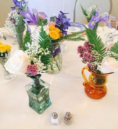 Fresh floral in small vases for centerpieces