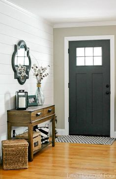 Entryway Update With SW Iron Ore. A front entryway gets an update with Sherwin Williams Iron Ore and a beautiful plank wall. Front Entryway Decor, Entrance Decor, Entryway Ideas, Entryway Paint, Interior Door Colors, Wood Interior Design, Yellow Interior, Country Interior, Interior Doors