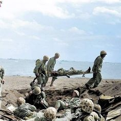 the_ww2_memoirs US Navy Corpsmen carry a wounded Marine on a stretcher to await the evacuation off the island of Iwo Jima while a group of Marines huddle in a shell hole that is providing some cover to them. 72 years ago today over 30,000 Marines stormed the shores of this tiny volcanic island making their mark on history forever. Years before the landings the Japanese commander in the island had predicted the Americans would attempt to land here and he began to build up his defenses. He did…