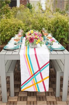 DIY Washi Tape: Use Washi Tape on solid color or fine patterned print to create this table cloth. Can also do on napkins, glasses, etc. I'll use the colors in the rug under the table.