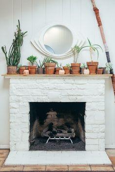 1 of 6 ways to make a beach home cozy | Kerry Knight | Beaten Green Brick Fireplace Decor, Stone Fireplace Designs, White Fireplace, Fireplace Mantels, Fireplace Ideas, Minimalist Fireplace, Fireplace Pictures, Christmas Fireplace, Cozy Fireplace