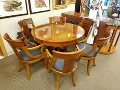 """Just arrived! Beautiful round 46"""" Baker table with two leaves and six padded chairs."""