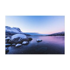 Beautiful canvas print featuring the snow covered shore of Narvik Fjord in the twilight hours as the sun struggles to rise above the horizon.