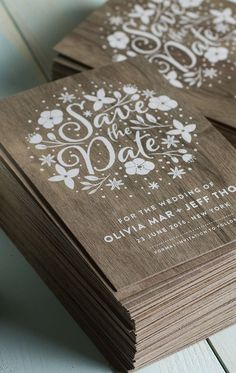 Stunning wedding invites produced on real wood with white printing.