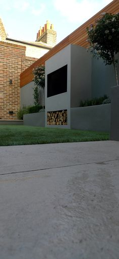 room outdoors limestone paving hardwood screen grey painted walls chic contemporary garden design and landscaping chelsea fulham clapham battersea london