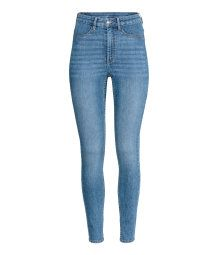 High-waisted jeans in washed superstretch denim with a zip fly and button, fake pockets at the front, real pockets at the back and super skinny legs.