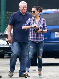 Mila Kunis looked comfy in a purple, blue, and white striped button up, distressed jeans, and a pair of sneakers while heading to lunch with her dad in L.A.