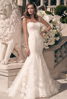 Brides: Casablanca Bridal. Eyelash fringed scalloped lace creates an organic edge along the front and back necklines, as well as the entire hemline.
