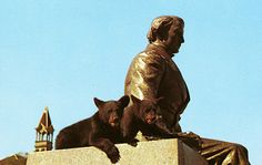 Topsy and Turvey, Baylor's two bear mascots in the 1950s, relax on the statue of Judge R.E.B Baylor.