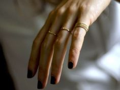 black nails and gold rings