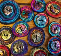 button-brooches that look like a beautiful rug design!