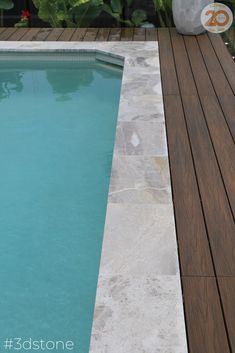 Nothing gives quite the same tropical feel as natural stone, blue hues and solid timber. Achieve the look and feel of an overseas holiday in your backyard. Our Toscano marble pairs perfectly with a wooden deck and inviting pool Modern Backyard Design, Scandinavian House, Pool Coping, Outdoor Pool, Outdoor Decor, Natural Stone Flooring, Tropical Pool, Wooden Decks, Stone Tiles