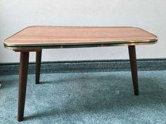 120 zł: Stolik pomocnik na drewnianych zwężanych nogach. Pokrytym laminatem imitujący drewno. Wykończony  lamówką w kolorze zlotym. Stan bardzo dobry. Na blacie widoczne ślady użytkowania. Wysokosc: 25,5 cm;... Coffe Table, Dining Table, Stan, Furniture, Home Decor, Homemade Home Decor, Dinning Table Set, Home Furnishings, Interior Design