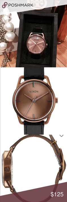 "Classic Nixon Watch NWT A minimalist's dream, the Mellor is pure excellence through simplicity. A smooth, classic, and timeless watch. Stainless steel case watch. Thee-hand quartz movement. Case measures 1.5"" diameter. Strap width measures 3/4"". Still in box never been used. Color is black/cooper. Price Firm Nixon Accessories Watches"