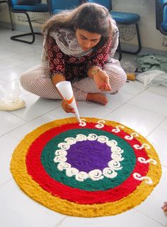 This Diwali, make a beautiful rangoli at your door step. Here are some stunning rangoli designs to get you started. Rangoli Designs Flower, Rangoli Patterns, Rangoli Ideas, Rangoli Designs Diwali, Rangoli Designs Images, Diwali Rangoli, Flower Rangoli, Beautiful Rangoli Designs, Ganesha Rangoli