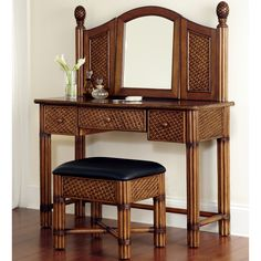 Get swept away to a tropical island when you put this beautiful wicker vanity table set in your home. This elegant vanity is crafted using natural-rattan wicker and mahogany and features carved pineapple finials on each side of the adjustable mirror.